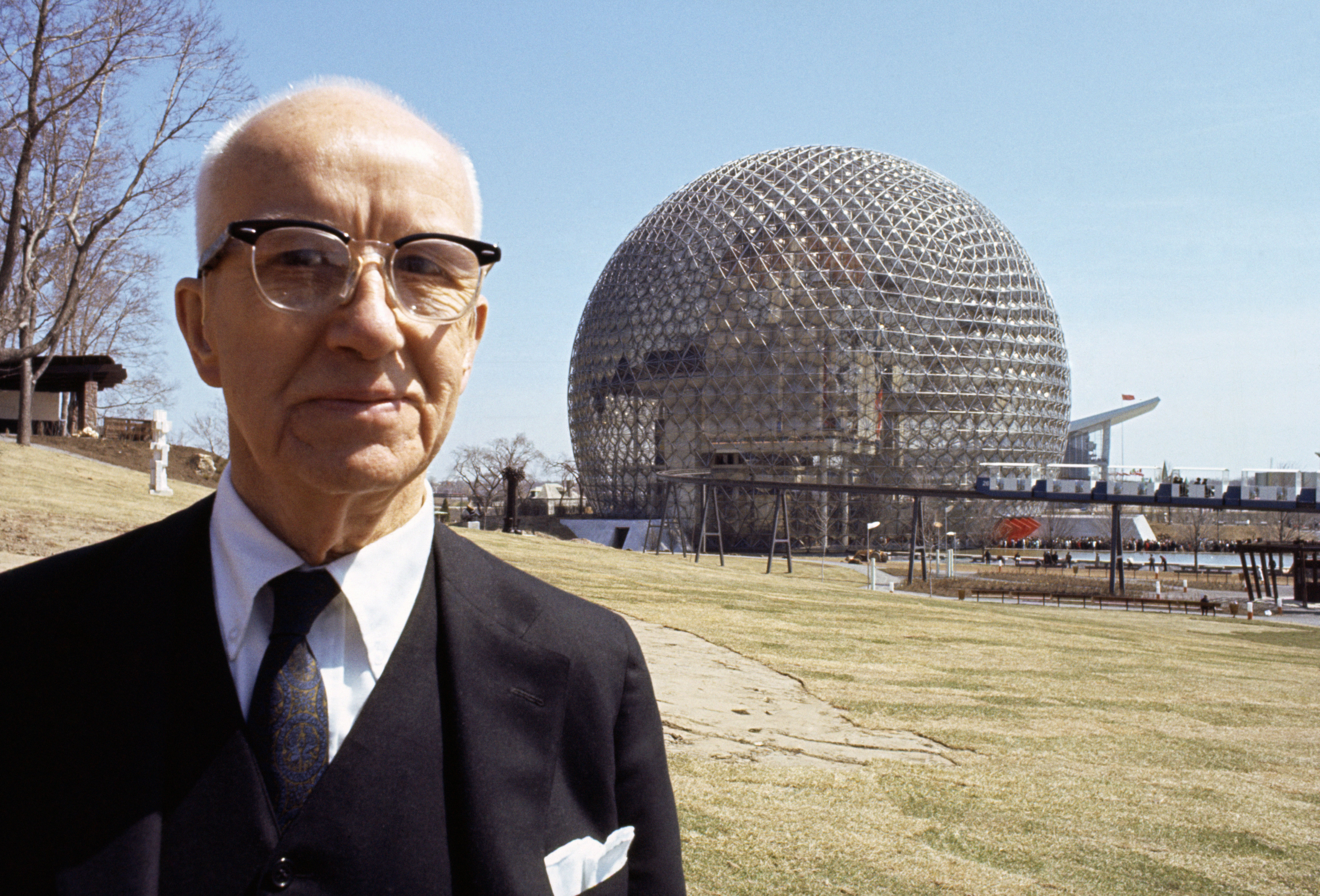 Buckminster Fuller before his geode dome at Montreal's World Fair.
