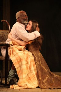 King Lear (Joseph Marcell) embraces daughter Cordelia (Bethan Cullinane) in KING LEAR (Photo by Ellie Kurttz.