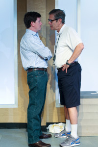 Peter (Keith Conallen) and the coach (Leonard C. Haas) face down in RED SPEEDO. Photo by Paola Nogueras.