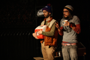 J Hernandez right, with Dave Johnson) in We Can All Agree to Pretend this Never Happened in Tiny Dynamite's A Play, A Pie and A Pint, October 2014 (Photo credit: Ilana Caplan)