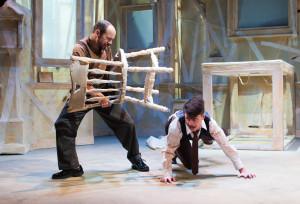 Father injures Gregor: Doug Hara as Mr. Samsa, Kristen Bailey as Gregor. Photo by Shawn May.