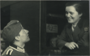 Alf Eger looking proudly at his bride Gritt on a German train, 1941.