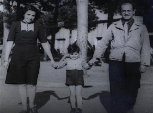 Lily and Fredl Spitz holding their son Roberto at the displaced persons' camp in Cinecittà, Italy, 1945. Ironically, Italy's largest film city was constructed during the Fascist era as part of a scheme to revive their film industry, but was taken over by the Allies as a displaced persons' camp after World War II.