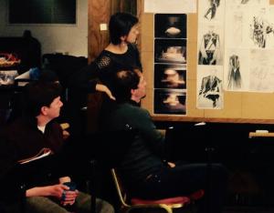 Director Blanka Zizka looks at sketches for HAMLET with actors Keith Conallen and Ross Beschler.