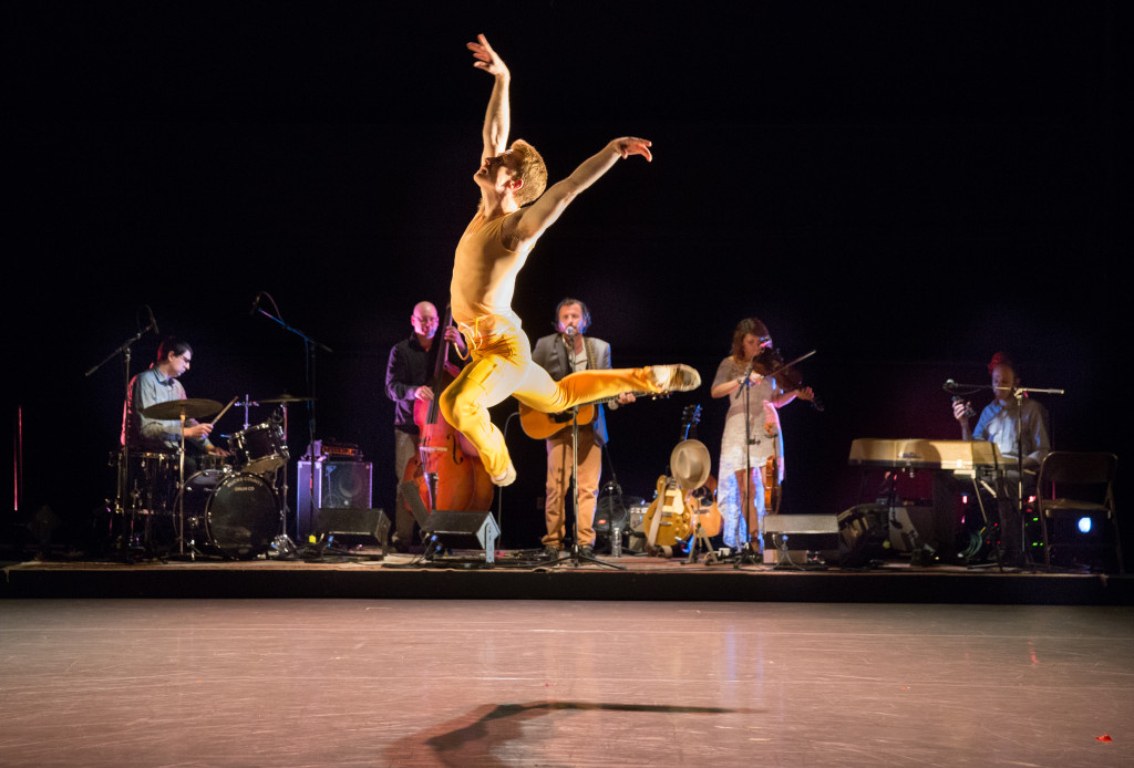 Daniel Mayo dancing a solo to the music of Chris Kasper and band in BalletX's SUMMER SERIES 2015. Photo by