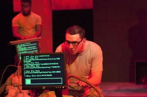 Johnny Smith (in front) with David Glover (behind) in Inis Nua Theatre Company's THE RADICALISATION OF BRADLEY MANNING (Photo credit: Katie Reing)