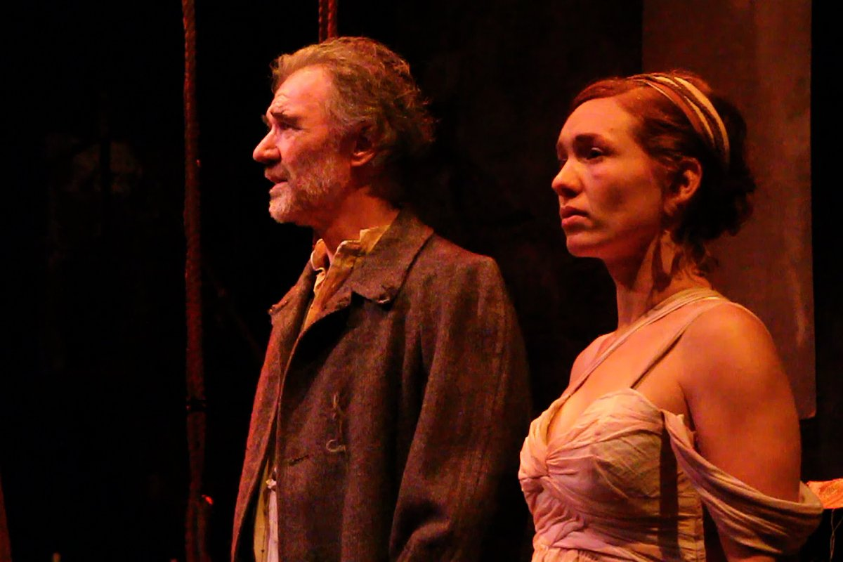 The Poet (Peter DeLaurier) and the Muse (Liz Filios) in AN ILIAD. Photo by Mark Garvin
