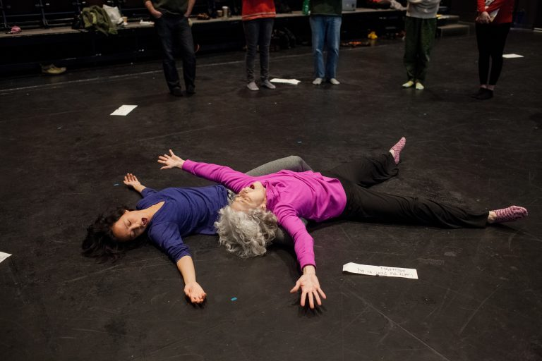 "Two of several performers who spend some time on the floor during Michael Kiley's music-movement ""experience"" Close Music for Bodies. Photo by Adachi Pimentel."