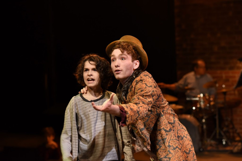 Lyam David Kilker (who shares the role with Bejamin Snyder) as Oliver and Jacob Entenman as The Artful Dodger. Photo by Shawn May.